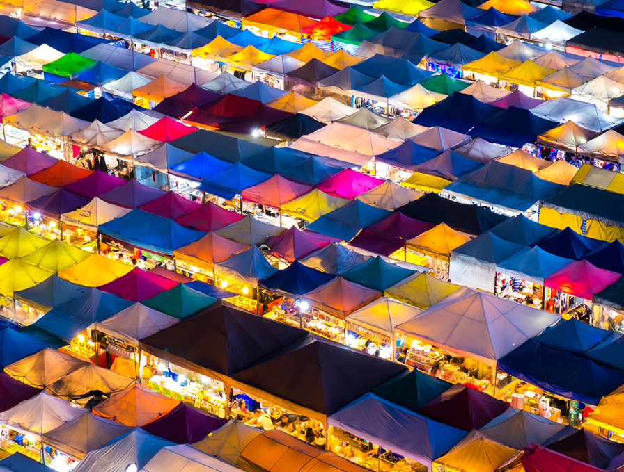 Retail - market tents in many colors by night
